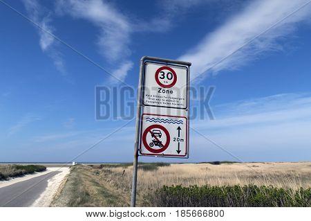 Traffic sign close to wadden sea beach on Fano island in Denmark.