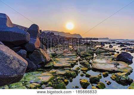 Seascape of waver barrier and sunset in Taiwan