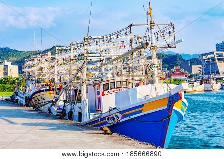 KEELUNG TAIWAN - APRIL 04: View of large fishing boats in Badouzi fishing village in the countryside of Keelung on April 04 2017 in Keelung