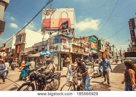 BANGALORE, INDIA - FEB 14, 2017: Crowd of people on the street with vehicles and many shopping centers on February 14, 2017. With population 8.52 million Bangalore is the third most populous indian city