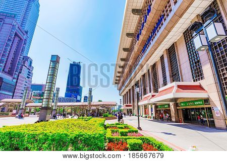 TAIPEI TAIWAN - APRIL 03: Taipei main station entrance with and city buildings located in the downtown area of Taipei on April 03 2017 in Taipei