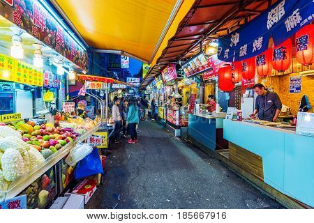 TAIPEI TAIWAN - MARCH 30: This is a small market street with street food vendors in Ximending shopping area at night on March 30 2017 in Taipei