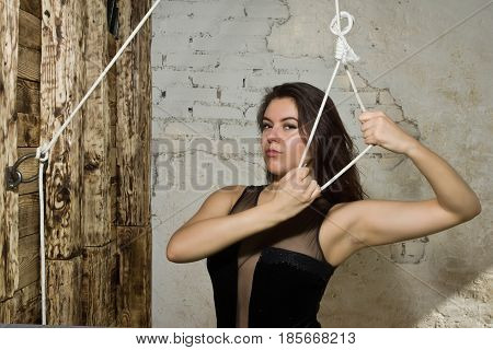 Beautiful  Woman Holding Loop Of The Rope