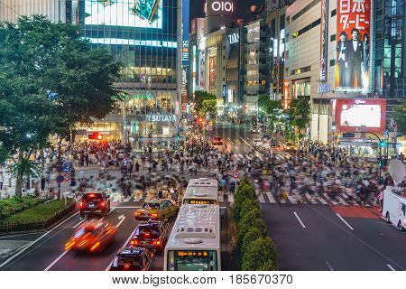 Tokyo, Japan. May 30, 2015. The shibuya district in Tokyo with blurred people. Shibuya is popular in Tokyo for his pedestrian cross where pedestrians cross in the same moment from all directions.
