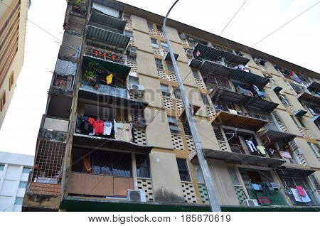 asian apartment building with laundry hanging at windows