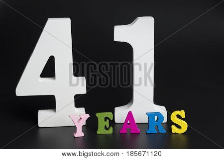 Letters And Numbers Forty-one Years On A Black Background.