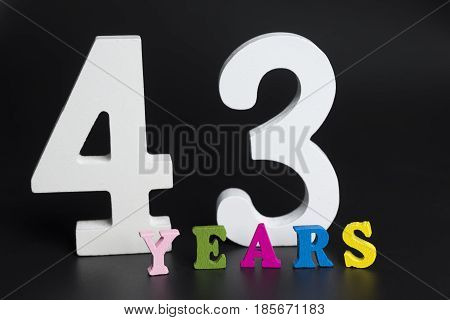 Letters And Numbers Forty-three Years On A Black Background.