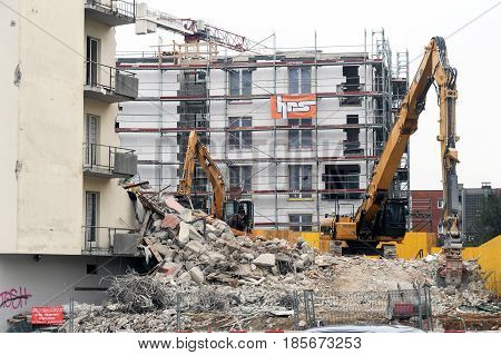 Construction Workers During Demolition Of A House With A Crane