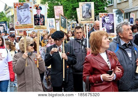 KURSK RUSSIA - May 92017: People in the crowd participating in Immortal Regiment procession in Victory Day.