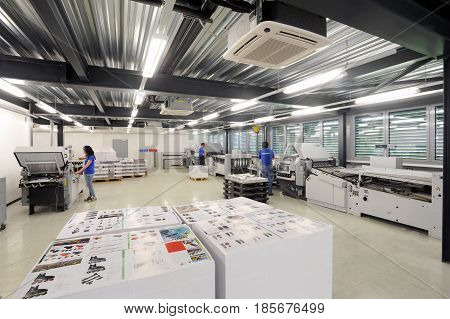 People Working At Offset Printing Machines