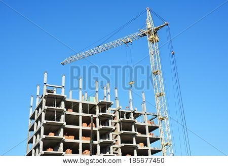 Tower Crane Picture with copy space. House Construction Building Site. Tower Crane building construction site with contractor on the top.