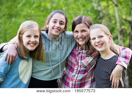 Portrait Of Young Girls Having Fun In Park Together