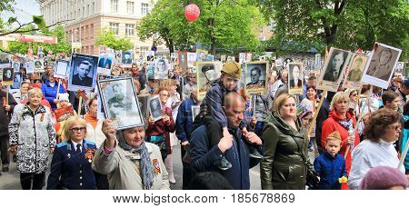 KURSK RUSSIA - May 92017: People in the crowd participating in Immortal Regiment procession in Victory Day. Panoramic view.