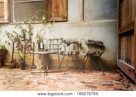 Old Wooden Chair Group At Country Home In Vintage Colour Effect