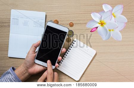 Coins And Flower On Book Bank Account For Money Saving Concept