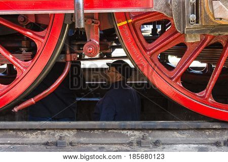 BERLIN - APRIL 21: The driver maintains a locomotive. Spring Festival Exhibition in the Rail yard Schoeneweide April 21 2013 in Berlin Germany