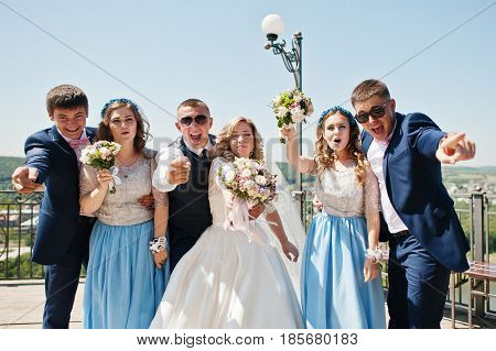 Wedding Couple With Bridesmaids On Blue Dresses And Best Mans Having Fun At Wedding Day.