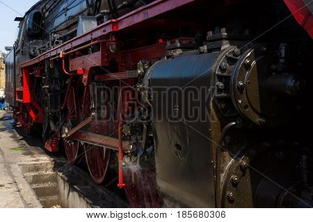 BERLIN - APRIL 21: Detail of an old steam locomotive Spring Festival Exhibition in the Rail yard Schoeneweide April 21 2013 in Berlin Germany