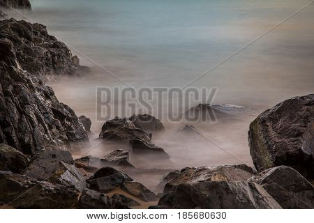 Long Exposure of Rocks and Waves at the Beach