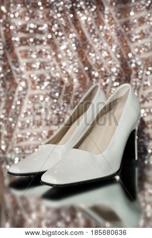 White lacquer women's shoes with high thin heels