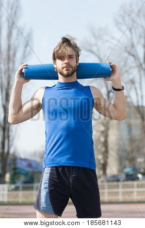 Yoga, Fitness Mat Blue Color In Hands Of Muscular Man