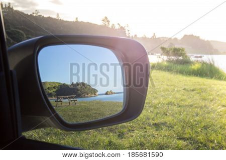 Road Trip View of Beach and Picnic Table with Sun Flare Bay of Islands New Zealand