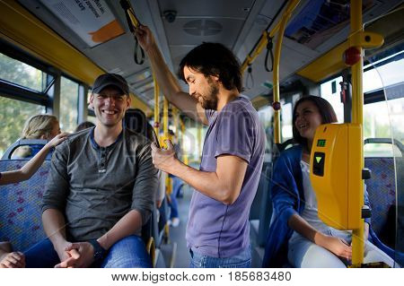 Passengers in the city bus. Modern public transport is convenient for children and adults.