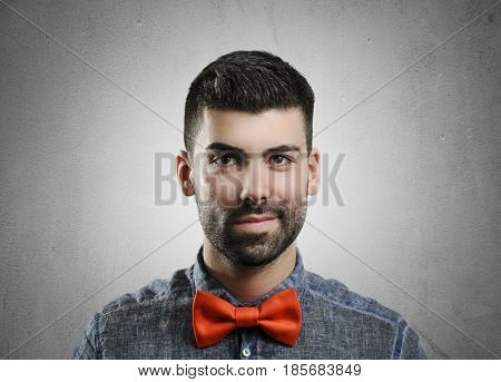 Portrait of young handsome man with red bowtie