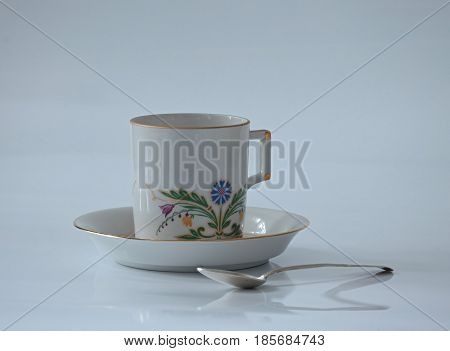 White cup with with a beautiful flower pattern white background