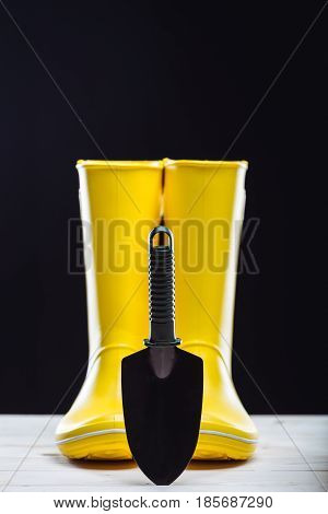 Rubber Boots And Garden Tool