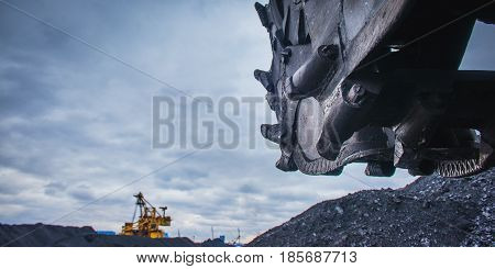 Coal mining industry. Close up view at a rotor of an excavator.