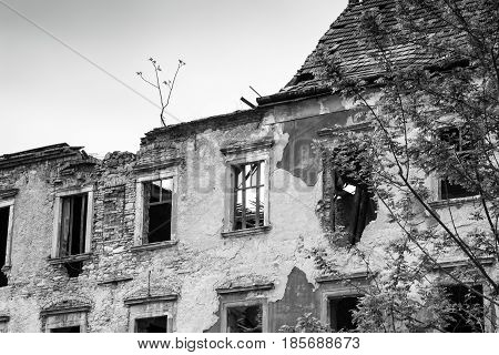 Ruines of old house war destroyed building black and white