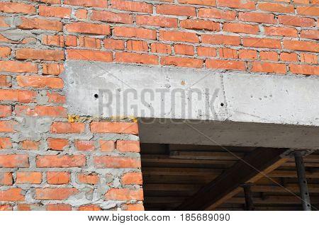 Close up on construction house door concrete lintel on brick house construction.