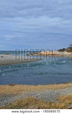 Seascape of the tide turning in Cohasset Massachusetts.