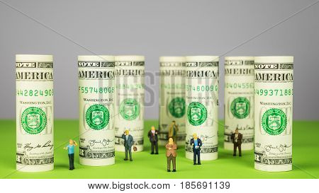 Rolled dollar banknote pillars from dollar money investors and dollar towers entrepreneurs