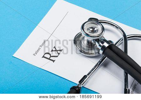 Closeup of a stethoscope on a rx prescription