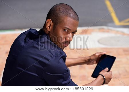 Cool Young Black Guy Holding Digital Tablet And Turning Around