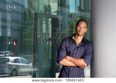 Cool Young Black Guy Leaning On Wall And Staring
