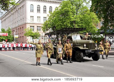 KURSK RUSSIA - May 92017: young people dressed on Soviet army uniform participating Immortal Regiment procession in Victory Day.