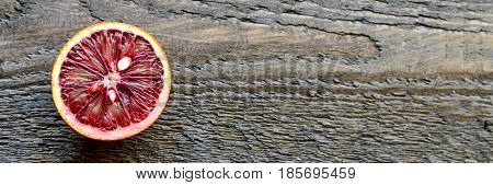 Sliced And Cut Sicilian Blood Oranges On Wooden Natural Background, Top View