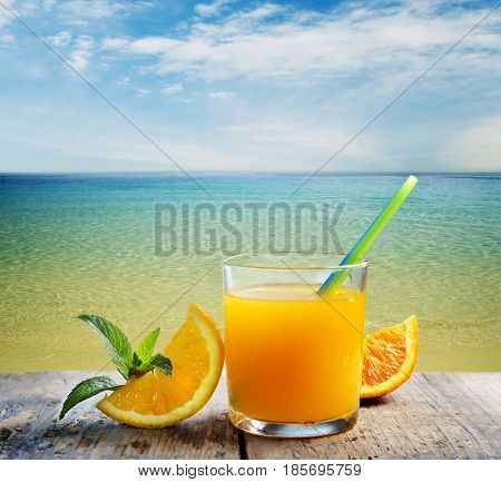 Summer orange cocktail on the beach. Summer refreshment on beach bar table.