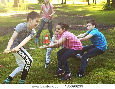 Moscow, Russia - May 31, 2016: Unidentified preteen kids play rope pull outdoor competition game in graduation school party in Moscow, May 31, 2016