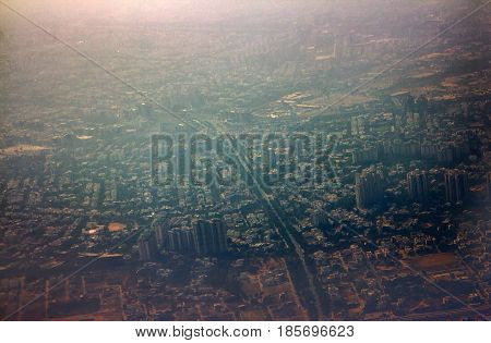 Journey By Air. A View Of City From Plane.