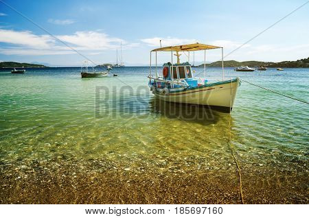 Colorful boat in Skiathos island Greece. Beautiful sea landscape in greece
