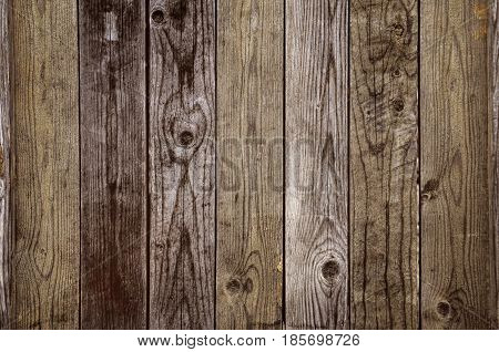 Brown wooden plank background in grungy style