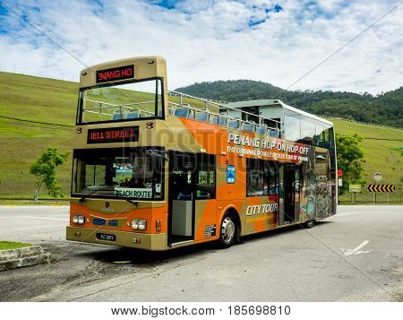 PENANG MALAYSIA - JUNE 3: The double decker hop-on hop-off bus of Penang for city tour of George town the UNESCO world heritage city and sightseeing around the island parking at the destination on June 3 2016.