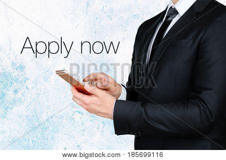 businessman using mobile smart phone near text