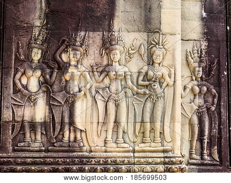 Stone carving of angels or Apsara on the wall of Angkor Wat the ancient Hindu temple complex in Cambodia