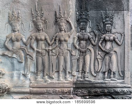 Stone carving of angels or Apsara on the wall of Angkor Wat, the ancient Hindu temple complex in Cambodia