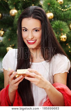 Happy young woman whith box gift on christmas time.